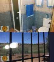 Baño y ventanas con mosquiteras